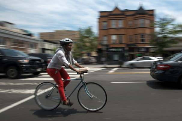 (Bonnie Jo Mount/ Washington Post ) - A bicyclist rides along 14th NW in Washington.