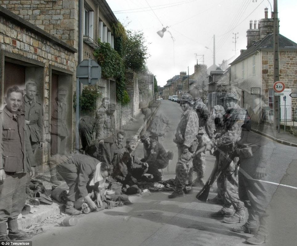 Changing environment: German soldiers surrendering beside the modern terraced houses of the Rue des Fossés Plissons in Domfront, Orne