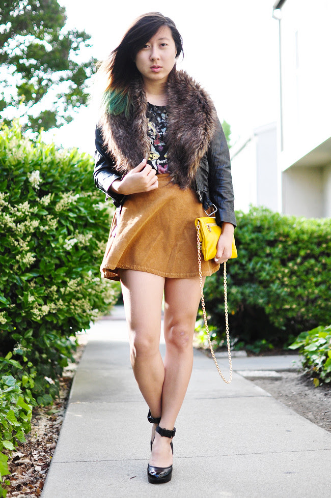 H&M faux leather crop jacket, H&M fur, Urban Outfitters tiger tee, American Apparel corduroy circle skirt, Nine West ankle-strap wedges, gifted yellow clutch