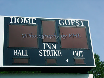a baseball score board sign