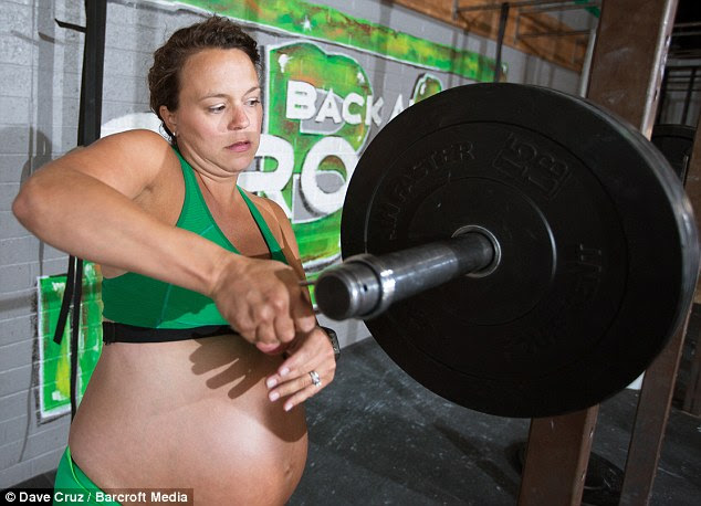 'I had an easy birth thanks to CrossFit,' says Meghan, pictured here at her gym just daysbefore the birth of her daughter Florence Germaine. 'I pushed for less than 20 minutes to welcome her to the world'