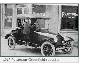 A child leans out of a 1917 Patterson-Greenfield roadster.