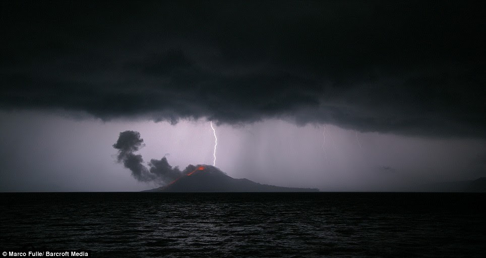 Natural beauty: Photographer Marco Fuller captures a storm passing over the fiery cone