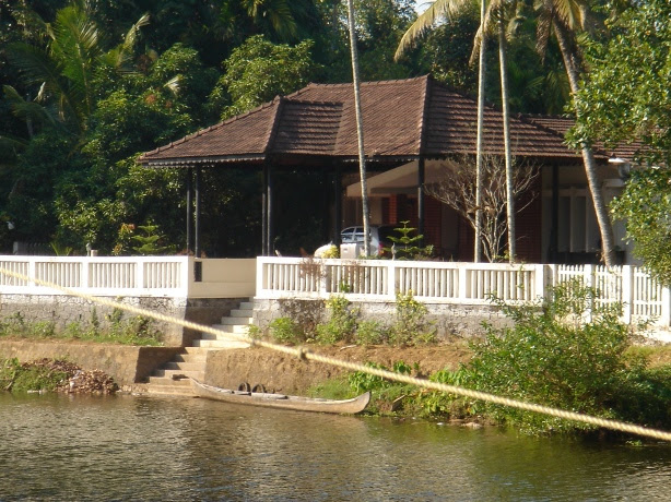 house seen on the other side of the backwaters from the house of paapi
