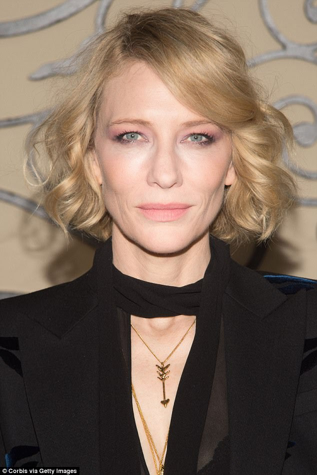 Glamorous: The 48-year-old accessorised with some necklaces and wore her blonde locks in a curled bob