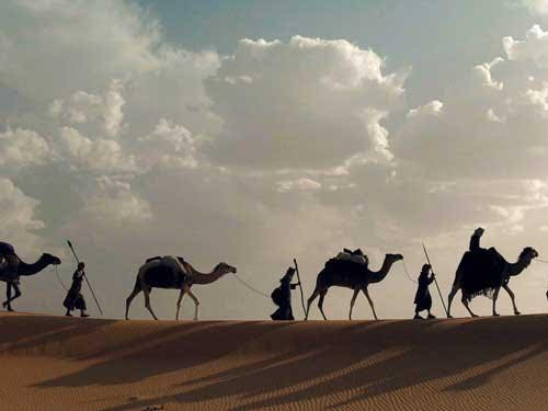 [Photo of wise men and camels on the horizon]