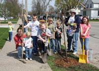 Youngsters help plant street trees in Sparta.