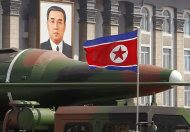 In this photo taken Sunday, April 15, 2012, what appears to be a new missile is carried during a mass military parade at the Kim Il Sung Square in Pyongyang, North Korea, to celebrate the 100th anniversary of the country's founding father Kim Il Sung. The photo shows the warhead's surface is undulated, suggesting it's a thin metal sheet unable to withstand flight pressure, analysts say. Adding more doubt to North Korea's claims of military prowess after its flamboyant rocket launch failure, analysts say the half dozen missiles showcased at the military parade were low-quality fakes. (AP Photo/Ng Han Guan)