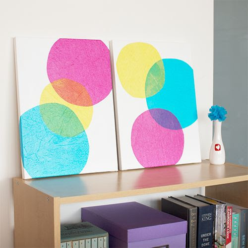 Tissue paper scrapbook paper on canvas? Could decoupage on...