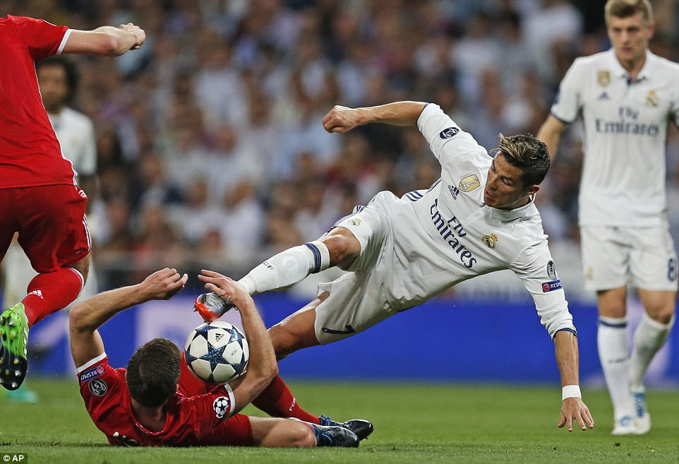 Ronaldo was scrapping hard to get his side on the front foot, he was penalised for this challenge with Xabi Alonso