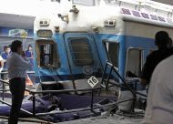 A view of the front of a commuter train that crashed into the Once train station during rush hour in Buenos Aires, February 22, 2012. Transport Secretary Juan Pablo Schiavi confirmed that 340 people were injured and that passengers were still trapped inside when the train's brakes failed.   REUTERS/Enrique Marcarian (ARGENTINA - Tags: DISASTER TRANSPORT TPX IMAGES OF THE DAY)