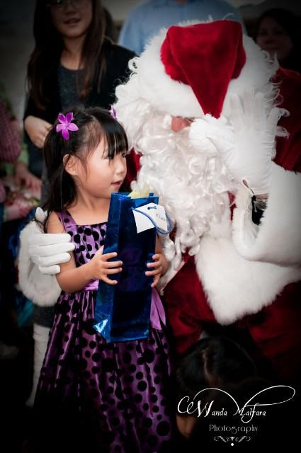 Mon Dec 5,2011, Milana finally made peace with her fear of the big man in red. He won her over.