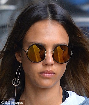 Sculptural shapes: Jessica Alba, 34, sports a single long artsy dangler while out and about recently