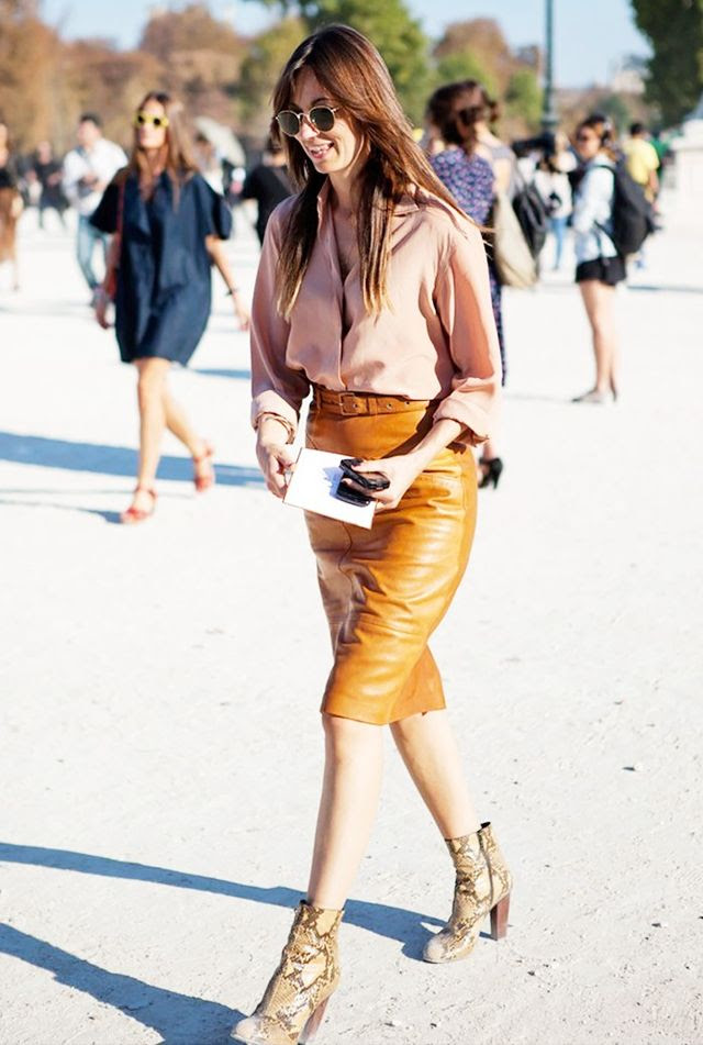 Go bold in a leather pencil skirt and snakeskin  heeled boots. Matched with a conservative blouse—this look is flawless.