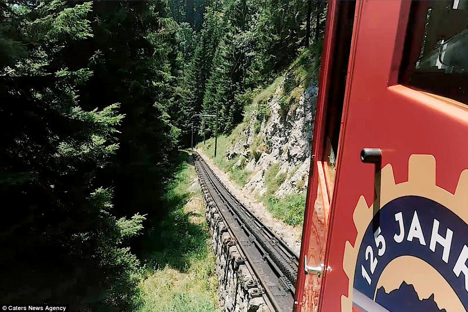 The view from the window of the Pilatus Railway in Switzerland. Trains travel to the top of Mount Pilatus at a gradient of 48 per cent