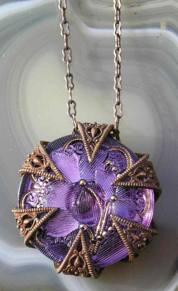 Clutched tight here is a splendid Czech glass floral stone in a rich shade of amethyst. Metallic gold accents, and held firmly by a RARE find-a superb old French brass 6-point filigree star with fabulous ginger patina, manipulated and coaxed into a setting. The star points hold the stone tightly. The piece has a rather ancient Middle Ages feel. Gothic-lly romantic. And a perfect gift for a February woman.