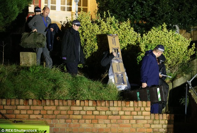 Evidence: Forensics remove items from Ms Blake's family home tonight after the bodies were found this afternoon