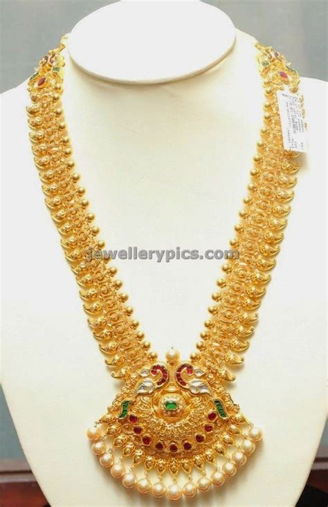 Gold Mango haram with peacock locket   Latest Jewellery
