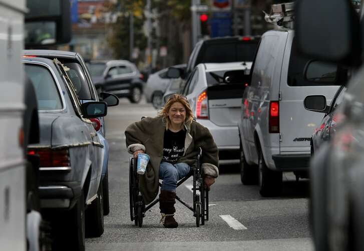 Vina Villegas can still be seen weaving in and out of stopped traffic with her wheelchair during commute hours. It has been more than ten years since a San Francisco Chronicle profile on the homeless people who lived and panhandled near a traffic island on South Van Ness Avenue in San Francisco, Calif.