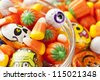 Spooky Orange Halloween Candy against a background - stock photo