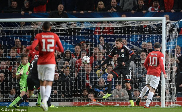 Back of the net: Rooney's cushioned shot bounces up past Leverkusen keeper Bernd Leno