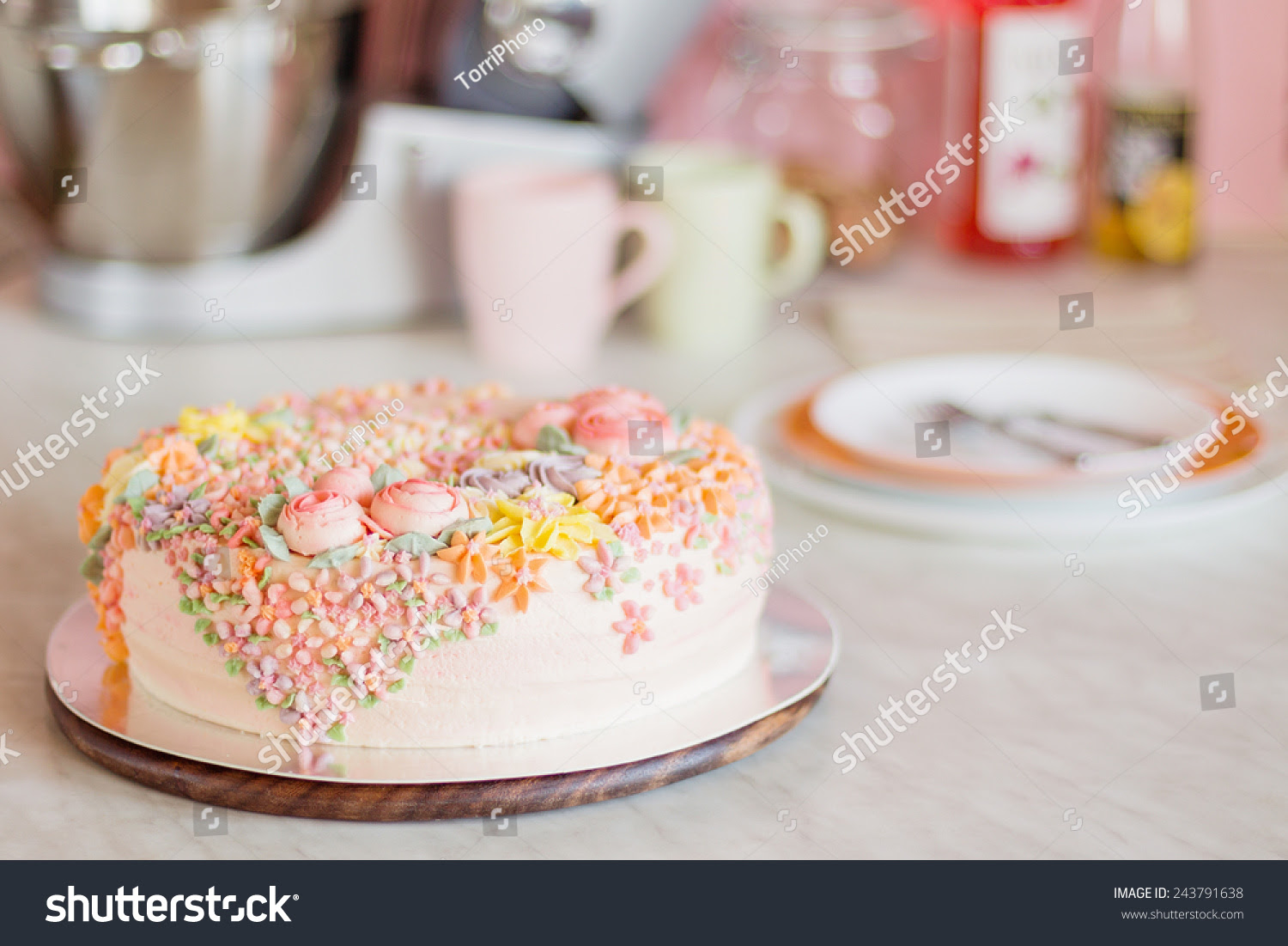 http://www.shutterstock.com/pic-243791638/stock-photo-pastel-pink-cake-decorated-with-cream-flowers-on-kitchen-pastel-colored-shallow-focus.html