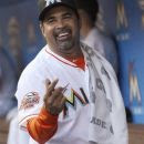 Miami Marlins manager Ozzie Guillen smiles before a baseball game against the Chicago Cubs, Tuesday, April 17, 2012, in Miami. Returning from a five-game suspension imposed by the team after he praised Fidel Castro, Guillen rejoined the team for Tuesday's game. (AP Photo/Wilfredo Lee)