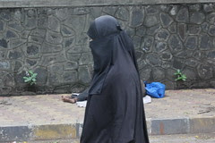 the muslim woman passes the soul of a dying man on the street by firoze shakir photographerno1
