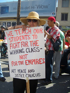 """Photo: sign saying, """"We teach our students to fight for the working class, not for the empires"""""""