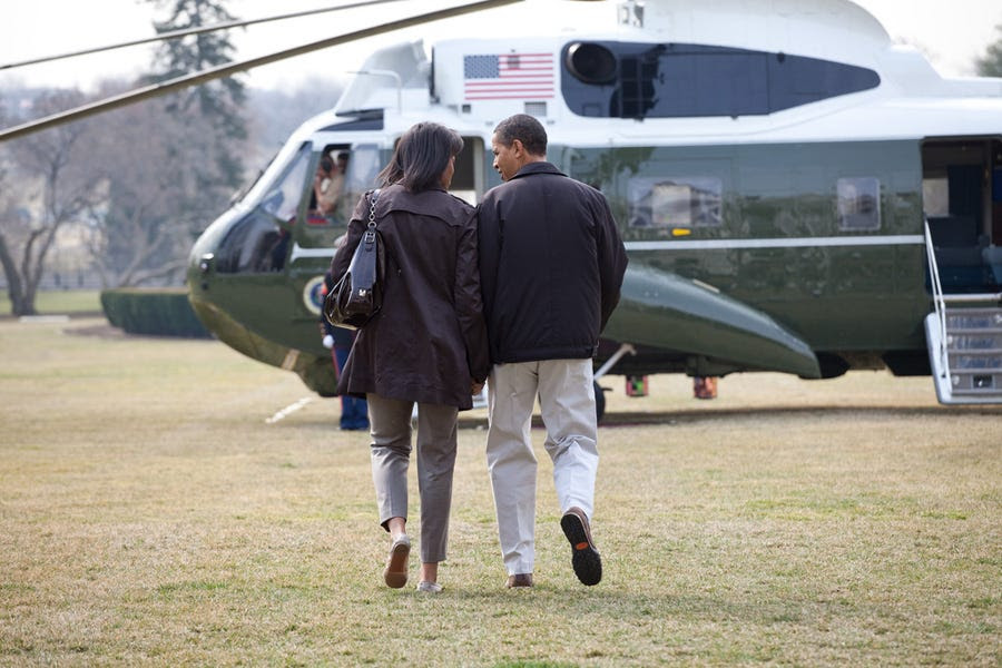 Holding hands while heading to Camp David for the first time in March 2009.