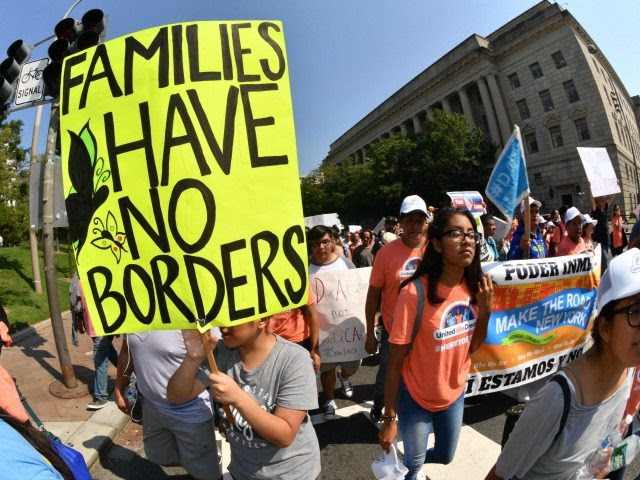 Immigrants and supporters demonstrate during a rally in support of the Deferred Action for Childhood Arrivals (DACA) program Hotel on September 5, 2017 in Washington DC. Trump on Tuesday ended DACA for 800,000 people brought to the US illegally as minors, leaving their future in serious doubt and triggering a political firestorm. The so-called 'Dreamers' now have between six months and just over two years until they become illegal US residents and subject to potential deportation. / AFP PHOTO / PAUL J. RICHARDS (Photo credit should read PAUL J. RICHARDS/AFP/Getty Images)