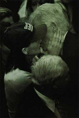 Clinton kissing unknown woman