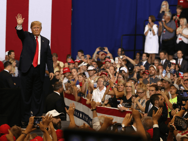 U.S. president Donald Trump greets supporters during a campaign rally at Scheels Arena on June 27, 2018 in Fargo, North Dakota. President Trump held a campaign style 'Make America Great Again' rally in Fargo, North Dakota with thousands in attendance. (Photo by Justin Sullivan/Getty Images)