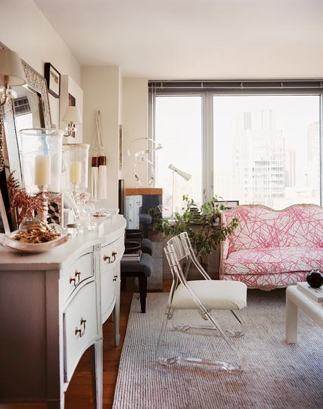 Living+Room+Lucite+chair+beside+white+sideboard+jOYjgVA7_lJl
