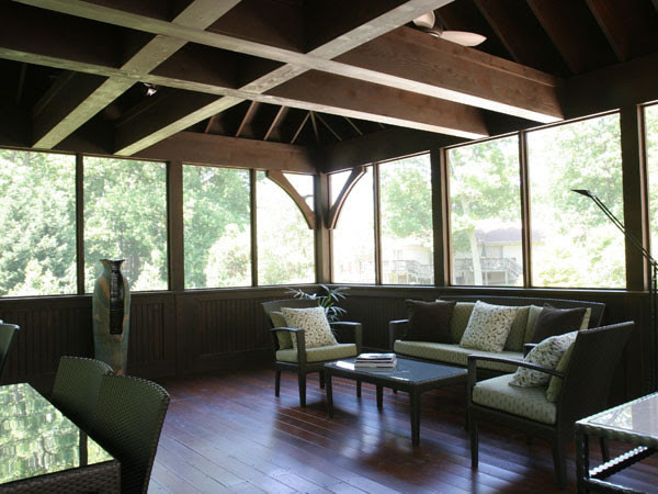 Screened Porch with Exposed Beams and Hardwood Floors - rustic ...