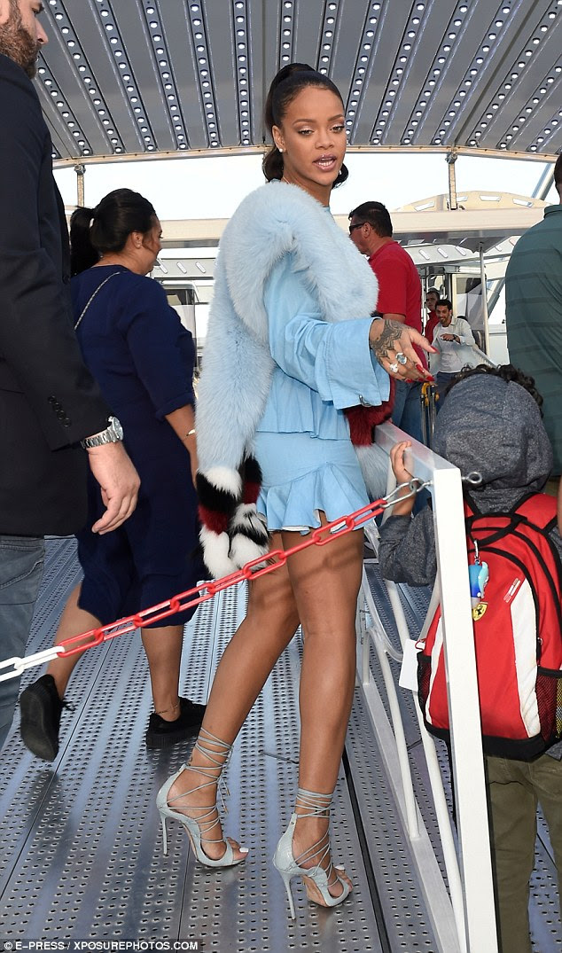 Main attraction: Rihanna turned heads as she strolled through the waiting area in her interesting get-up