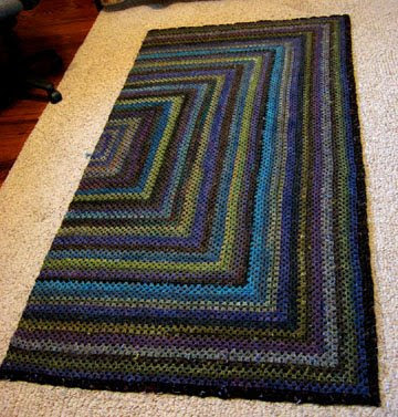 Granny square crocheted afghan of handspun yarns