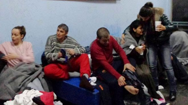 Survivors of Friday's boat sinking off Kalolimnos change clothes