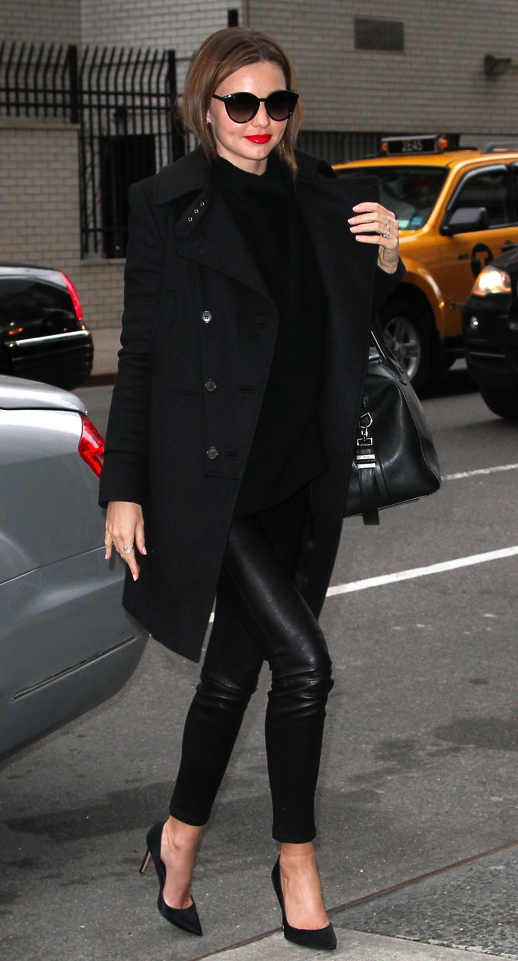 LE FASHION BLOG MIRANDA KERR MODEL OFF DUTY ALL BLACK BLACK ON BLACK NEW YORK CITY FEBRUARY 2013 RED LIPS LIPSTICK ROUND SUNGLASSES  BLACK COAT TEXTURED SWEATER SKINNY LEATHER PANTS GIVENCHY ANTIGONA CLASSIC BLACK PUMPS HEELS  DIAMOND RING  2