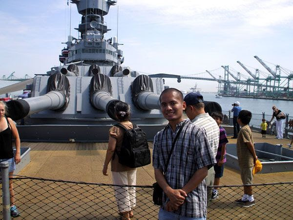 Posing in front of a 16-inch gun turret aboard the USS Iowa in San Pedro, California...on August 7, 2012.