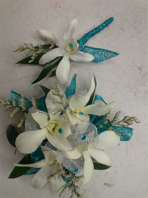 White dendrobium orchid and teal sparkle ribbon prom set
