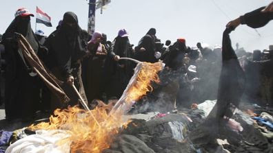Yemeni women burn their veils in a protest demonstration against the US-backed government of President Saleh. The people have been protesting for months against the repressive regime. by Pan-African News Wire File Photos