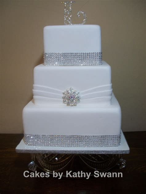 Square Wedding Cakes. Lov that it is sitting on a class