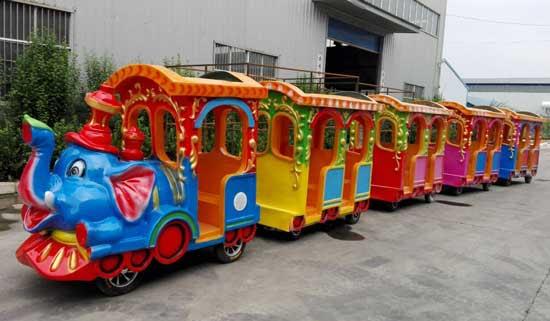 amusement park elephant train ride with 4 coaches