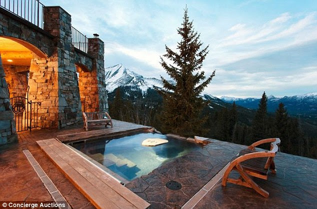 Great outdoors: The lavish dwelling includes an outdoor hottub surrounded by a deck made of moss stone and overlooking the picturesque mountains