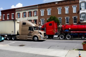"""Trucks drive down Towanda's main drag. Click on the image to view StateImpact Pennsylvania's new multimedia project, called """"Boomtown."""""""