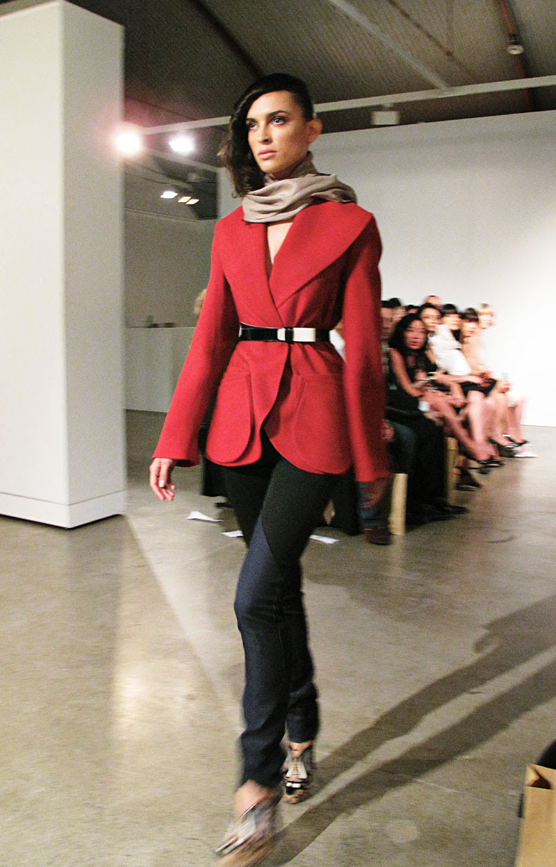 Carl Kapp, short red coat with pocket detail, two tone belt worn with tailored jeans. AW10