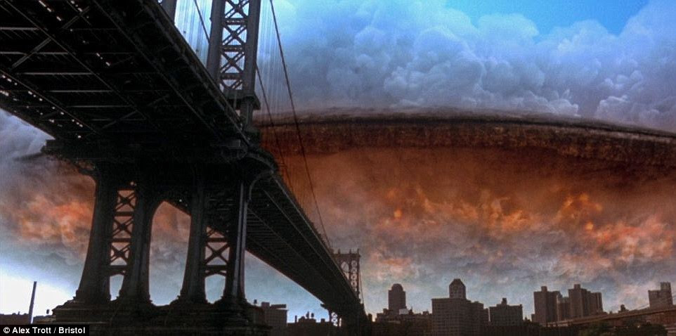This still from the sci-fi blockbuster Independence Day shows an enormous spacecraft materialising from the clouds to herald the beginning of the film's intergalactic conflict