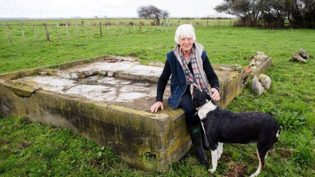 Mary Bielski with dog Lass, on her Shannon farm, where she has been uncovering a political prison work camp for ...