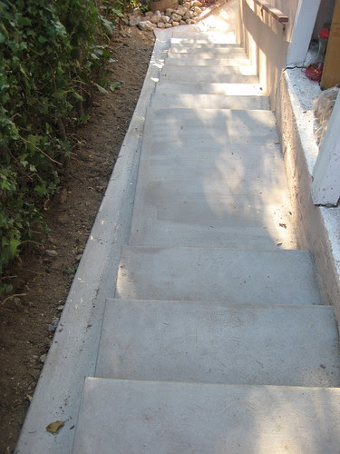 new stairs on side of house, with drainage